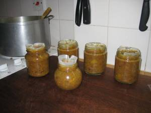 Hot chutney in hot jars with wax discs in place.